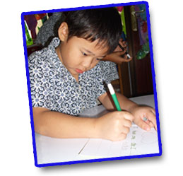 Kindergarden kids writing
